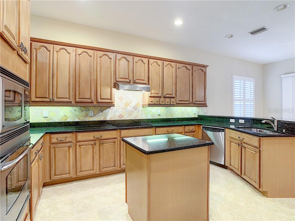 Large, open Kitchen space.  Stainless Steel GE Profile Appliances, along with Granite Counters and Custom Maple Cabinets are any chef's dream! - Single Family Home for sale at 8111 Santa Rosa Ct, Sarasota, FL 34243 - MLS Number is A4454464