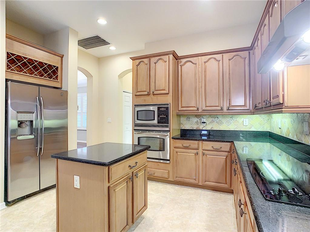 Look at the custom Wine Rack as well as the Island with Storage and Power- perfect for baking and prep work! - Single Family Home for sale at 8111 Santa Rosa Ct, Sarasota, FL 34243 - MLS Number is A4454464