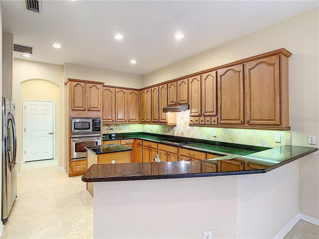 Open design to living area, this Kitchen is perfect for entertaining! - Single Family Home for sale at 8111 Santa Rosa Ct, Sarasota, FL 34243 - MLS Number is A4454464