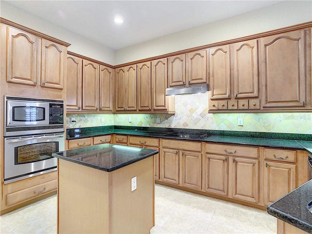 Cabinets and Storage GALORE! Stone Backsplash is beautiful and adds texture to the space. - Single Family Home for sale at 8111 Santa Rosa Ct, Sarasota, FL 34243 - MLS Number is A4454464