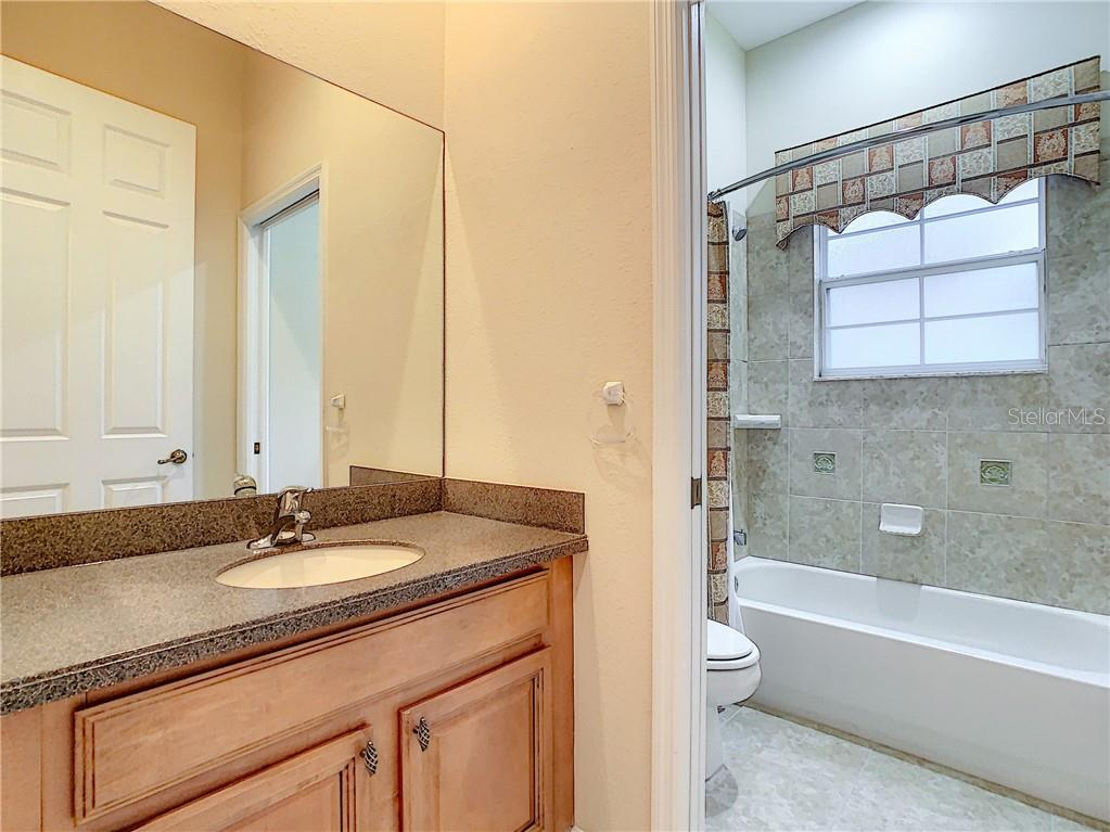 Downstairs Guest/In-Law Bath.  Located next to In-Law Bedroom. So convenient!! - Single Family Home for sale at 8111 Santa Rosa Ct, Sarasota, FL 34243 - MLS Number is A4454464