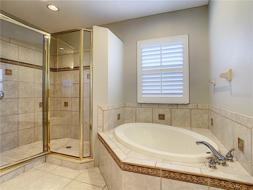 Look at these amenities!  Oversized Shower and stand alone Garden Tub! Upgraded Tile and Hardware lend to the spa like feeling of this room. - Single Family Home for sale at 8111 Santa Rosa Ct, Sarasota, FL 34243 - MLS Number is A4454464