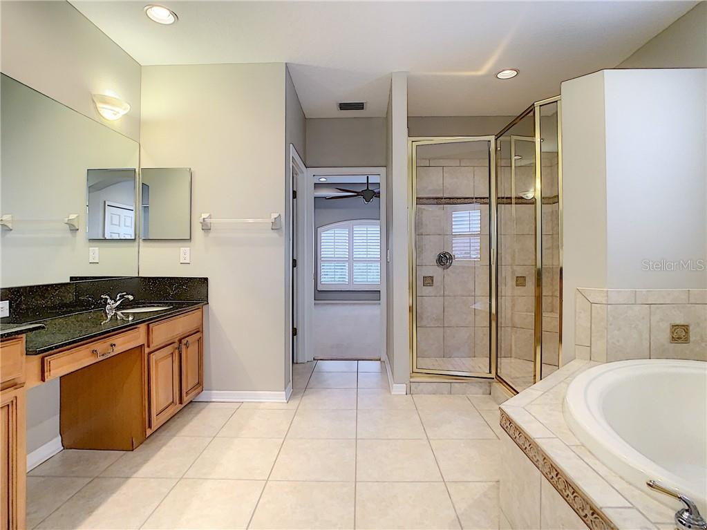 Large Master Bath with Dual Sinks, Granite Counters and Maple Cabinetry.  Spacious Vanity area is perfect for