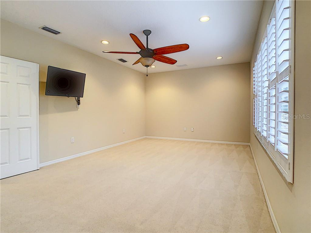 So much room for activities!!  Look at this space!  Upstairs Office/Flex Space- Perfect for a Study/Game Room/Exercise - you decide!  Mounted TV conveys. - Single Family Home for sale at 8111 Santa Rosa Ct, Sarasota, FL 34243 - MLS Number is A4454464