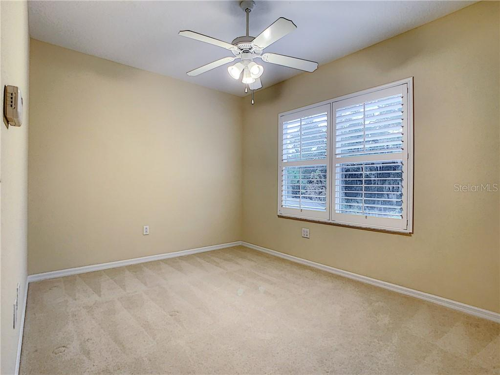 Bedroom #3 Upstairs - neutral and ready for your personal touch! - Single Family Home for sale at 8111 Santa Rosa Ct, Sarasota, FL 34243 - MLS Number is A4454464