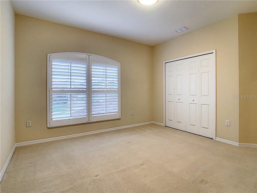 Upstairs Bedroom #4 - move-in ready!  Large square footage for so many bedrooms- - Single Family Home for sale at 8111 Santa Rosa Ct, Sarasota, FL 34243 - MLS Number is A4454464