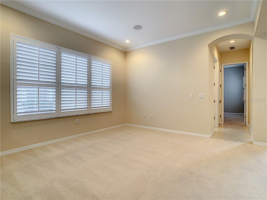 Upstairs Office/Den - Large with great windows to fill the space with natural light. Crown Moulding and Plantation Shutters are awesome! Add a Closet and you have a 5th Bedroom! - Single Family Home for sale at 8111 Santa Rosa Ct, Sarasota, FL 34243 - MLS Number is A4454464