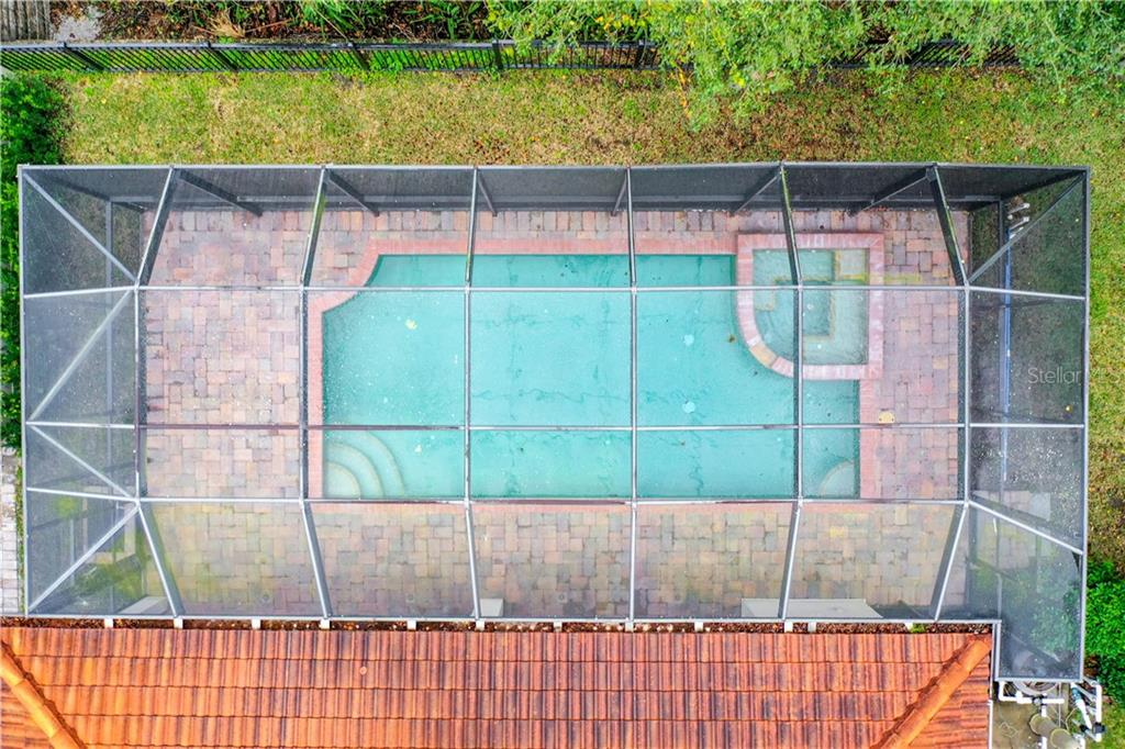 How fun!  Great shot of the pool and tiled roof.  Fenced across the backyard, you will spot amazing wildlife living safely in the Conservatory. - Single Family Home for sale at 8111 Santa Rosa Ct, Sarasota, FL 34243 - MLS Number is A4454464