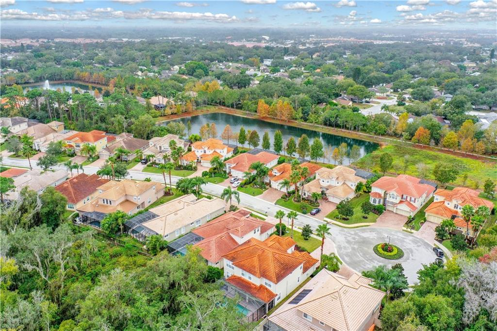 An aerial view of this beautiful home located within the Cul-de-Sac with Conservatory behind and Lakes to the left.Private entrance to the Park is along the Gate one house over! - Single Family Home for sale at 8111 Santa Rosa Ct, Sarasota, FL 34243 - MLS Number is A4454464