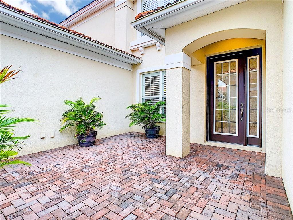 Lovely space that could be used as an additional outdoor living area. Nice inlay detail work on front door and side panel for added privacy. - Single Family Home for sale at 8111 Santa Rosa Ct, Sarasota, FL 34243 - MLS Number is A4454464
