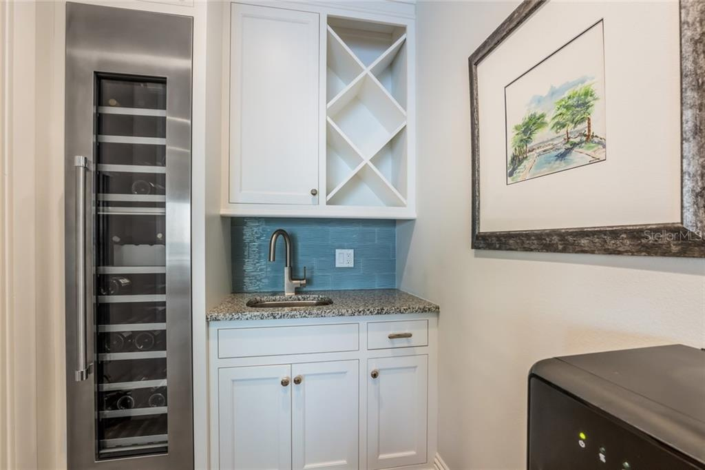 Wet bar with granite counters and Thermidor wine fridge - Single Family Home for sale at 834 S Bay Blvd, Anna Maria, FL 34216 - MLS Number is A4455941