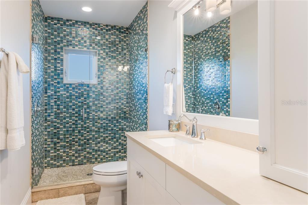 Full bathroom with stone flooring on 3rd level to accommodate all of your