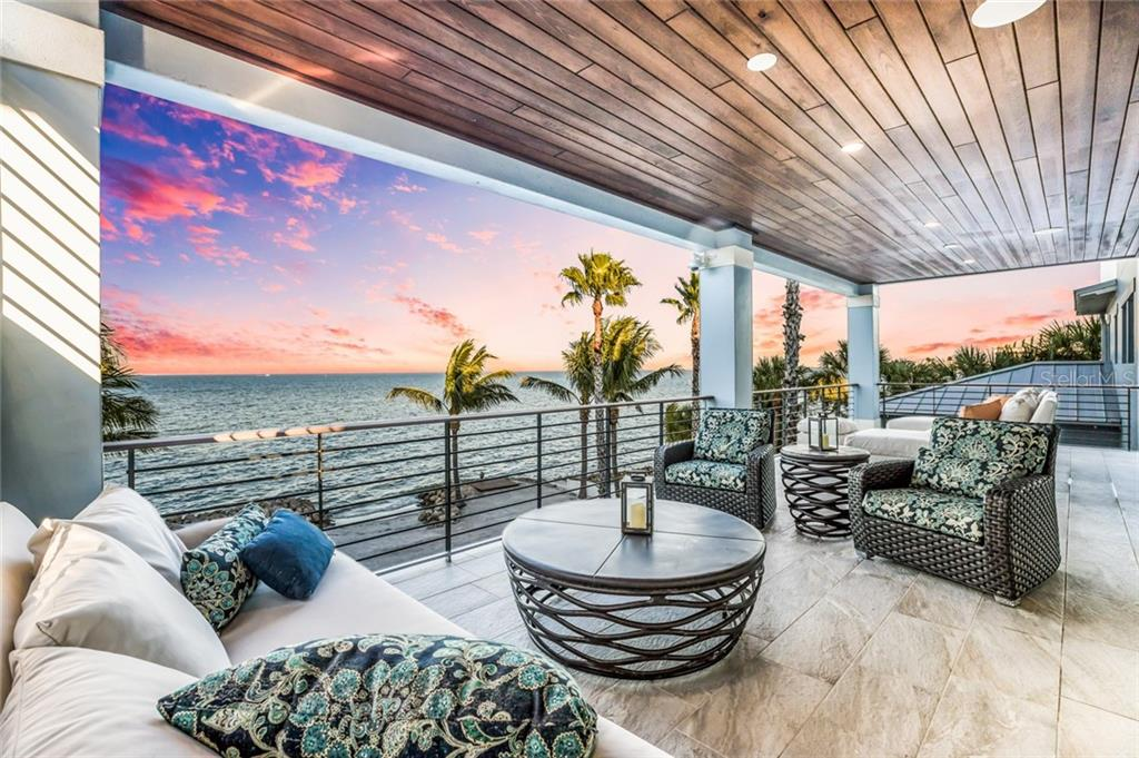 Relax and unwind after a busy day on the covered porch on 3rd level - Single Family Home for sale at 834 S Bay Blvd, Anna Maria, FL 34216 - MLS Number is A4455941