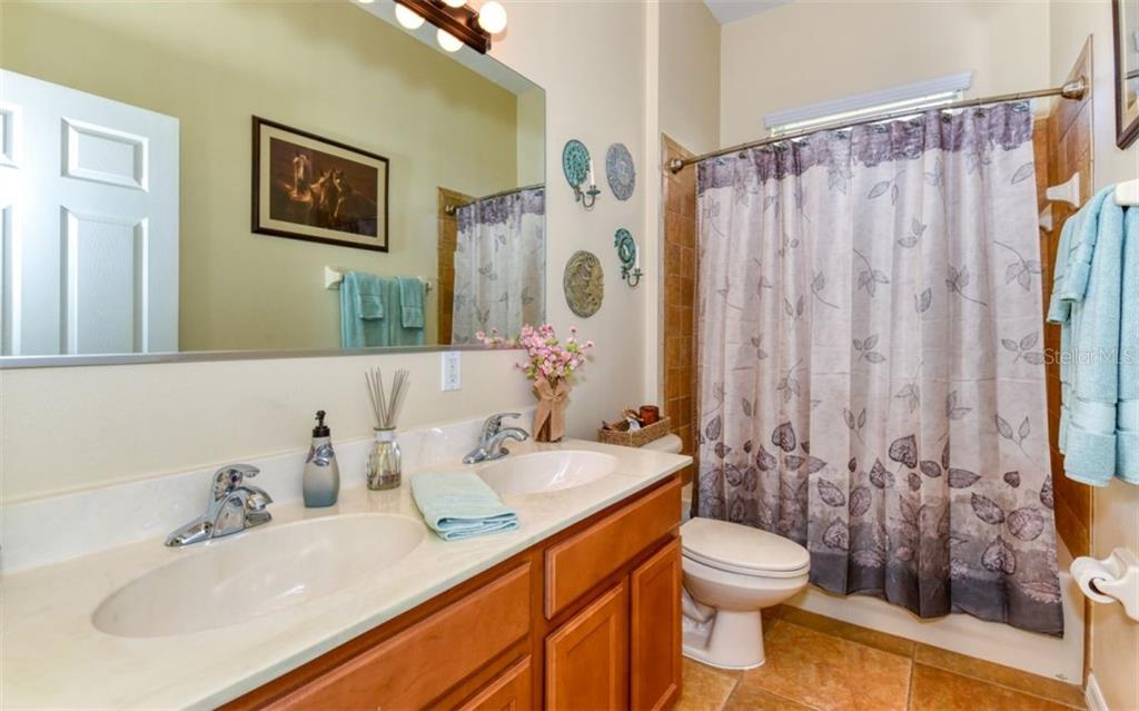 2nd bathroom with tub/shower and double sink vanity. - Single Family Home for sale at 15327 Blue Fish Cir, Lakewood Ranch, FL 34202 - MLS Number is A4456840