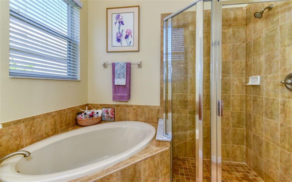 Master garden tub and shower. - Single Family Home for sale at 15327 Blue Fish Cir, Lakewood Ranch, FL 34202 - MLS Number is A4456840
