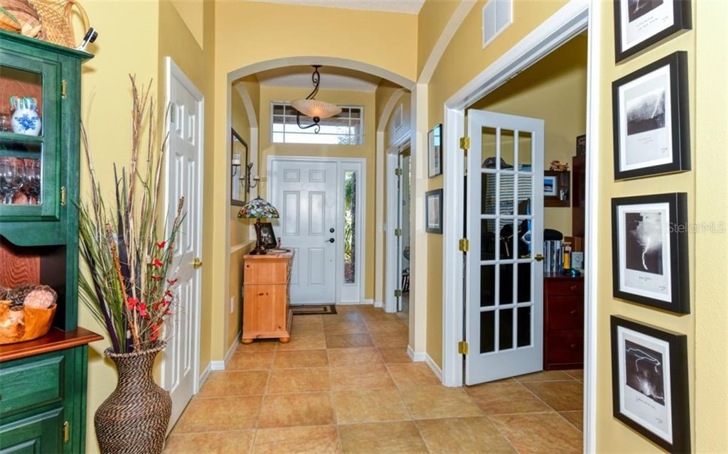 Entryway showing the two additional rooms with French doors on right. - Single Family Home for sale at 15327 Blue Fish Cir, Lakewood Ranch, FL 34202 - MLS Number is A4456840