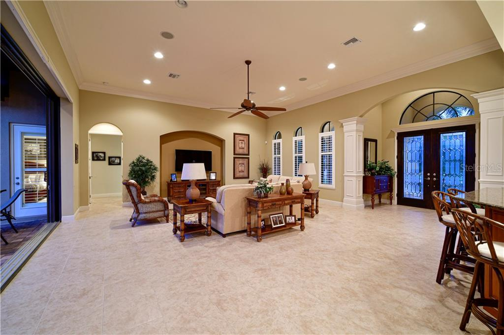 Great Room, with pocket doors overlooking Extended Lanai - Single Family Home for sale at 11806 Rive Isle Run, Parrish, FL 34219 - MLS Number is A4457432