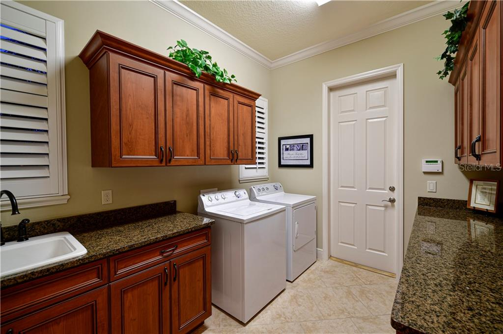 Expansive Laundry room, with upgraded cabinets, granite, sink and storage. - Single Family Home for sale at 11806 Rive Isle Run, Parrish, FL 34219 - MLS Number is A4457432