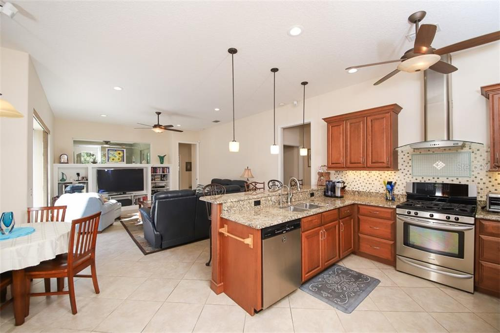 Kitchen, family room and breakfast nook. - Single Family Home for sale at 6229 Yellow Wood Pl, Sarasota, FL 34241 - MLS Number is A4457471