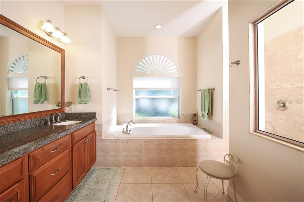 Master Bath with separate tub and shower - Single Family Home for sale at 6229 Yellow Wood Pl, Sarasota, FL 34241 - MLS Number is A4457471