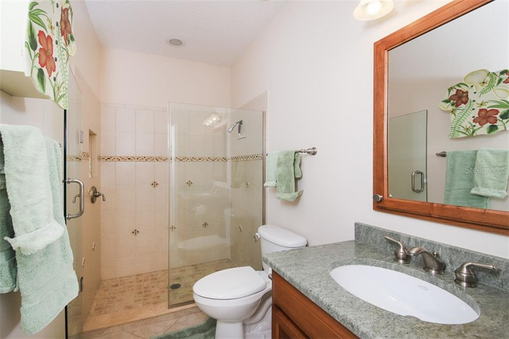 Guest Suite bath - Single Family Home for sale at 6229 Yellow Wood Pl, Sarasota, FL 34241 - MLS Number is A4457471