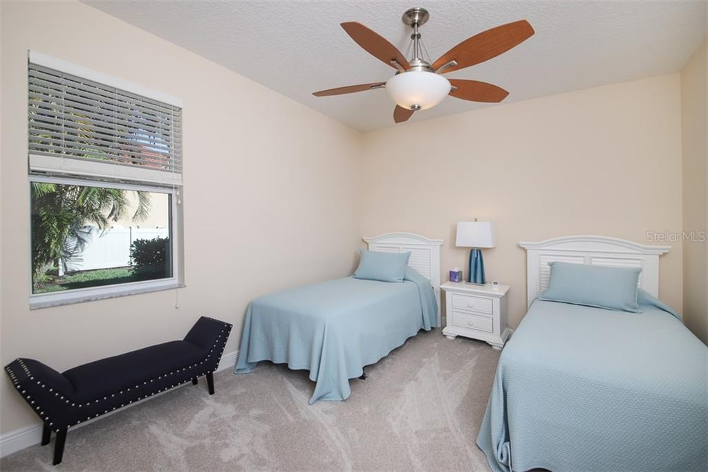 Guest Bedroom - Single Family Home for sale at 6229 Yellow Wood Pl, Sarasota, FL 34241 - MLS Number is A4457471