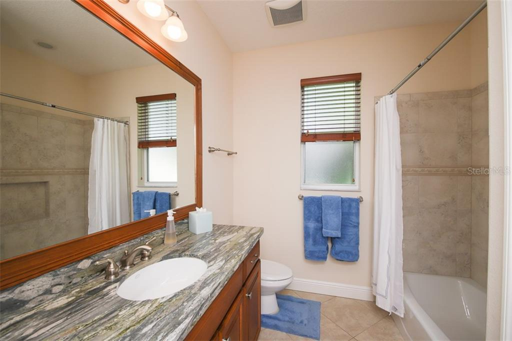 Guest Bath - Single Family Home for sale at 6229 Yellow Wood Pl, Sarasota, FL 34241 - MLS Number is A4457471