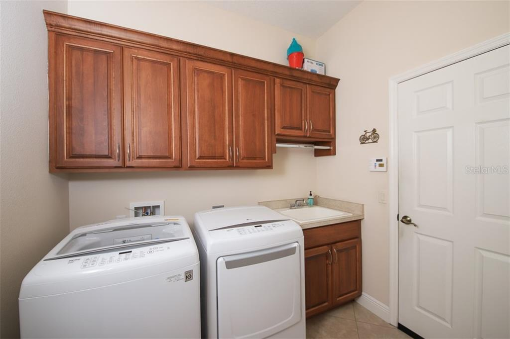 Laundry Room with sink, cabinets and closet - Single Family Home for sale at 6229 Yellow Wood Pl, Sarasota, FL 34241 - MLS Number is A4457471