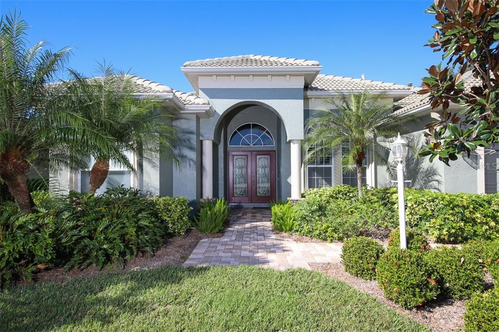 Entrance, beautiful leaded glass double doors - Single Family Home for sale at 6229 Yellow Wood Pl, Sarasota, FL 34241 - MLS Number is A4457471