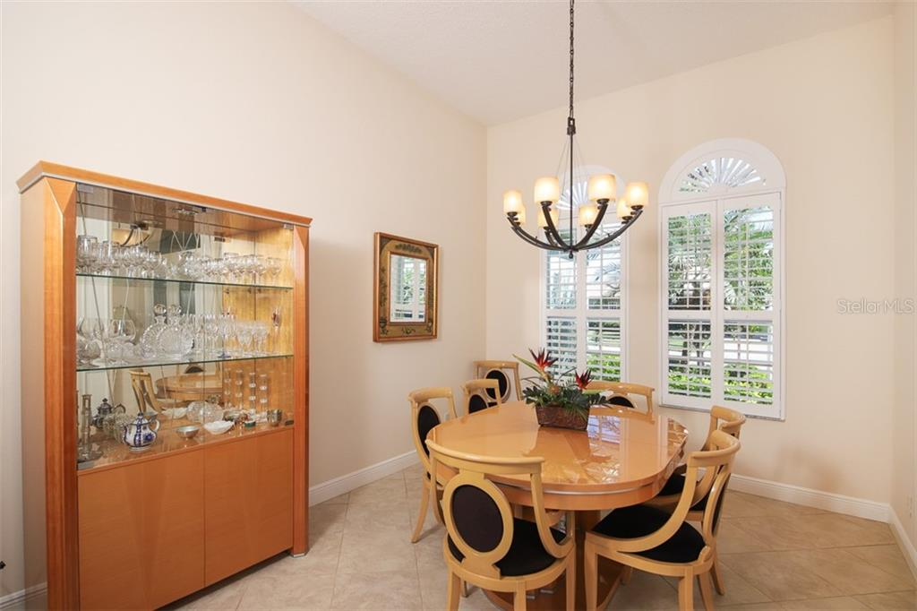 Separate elegant formal dining room with custom window treatments - Single Family Home for sale at 6229 Yellow Wood Pl, Sarasota, FL 34241 - MLS Number is A4457471