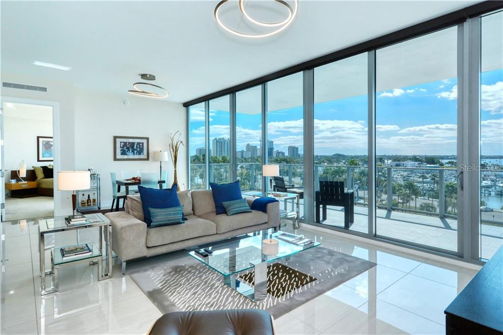 Great room living & dining areas - 10' wall of windows & sliders - Condo for sale at 1155 N Gulfstream Ave #507, Sarasota, FL 34236 - MLS Number is A4458926