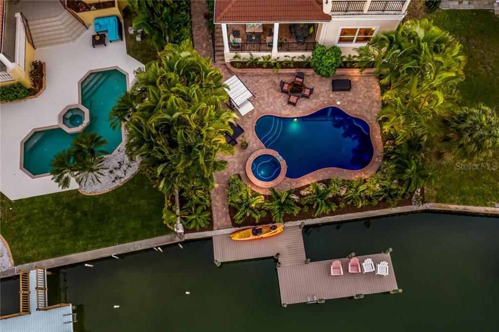 Aerial view. Evening poolside. - Single Family Home for sale at 443 S Polk Dr, Sarasota, FL 34236 - MLS Number is A4459240