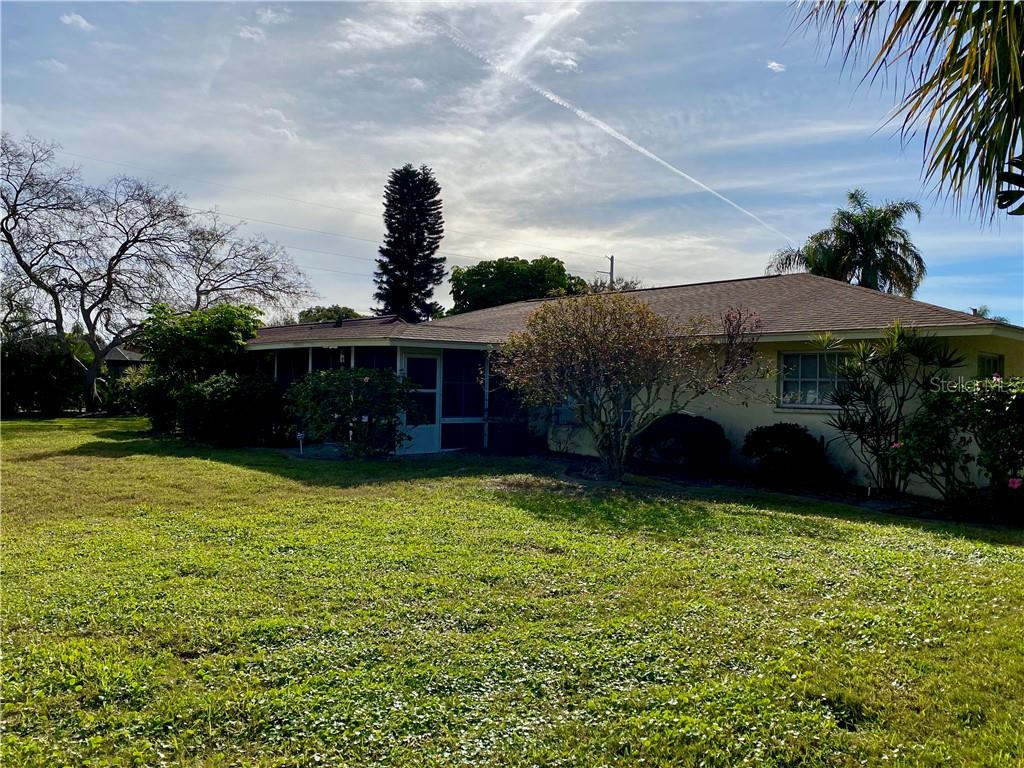 Huge yard off of the screened patio - Single Family Home for sale at 7116 18th Ave W, Bradenton, FL 34209 - MLS Number is A4459537