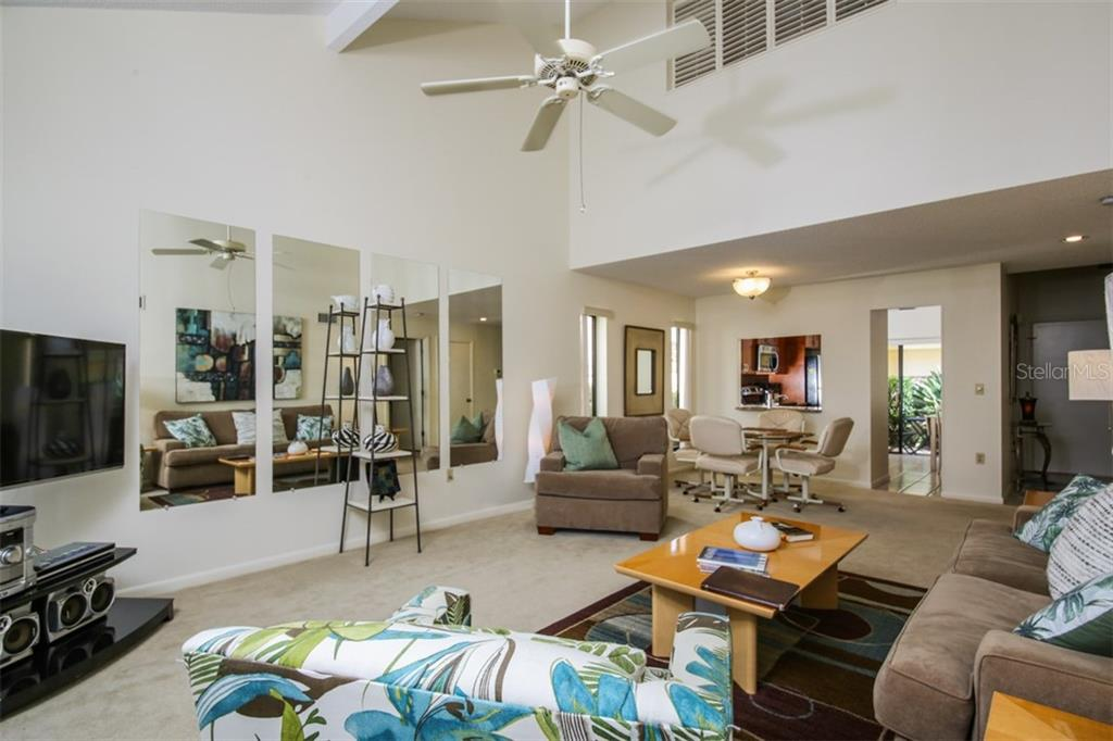 View of great room toward dining room, kitchen and foyer.  Spacious and cozy. - Townhouse for sale at 5319 Huntingwood Ct #51, Sarasota, FL 34235 - MLS Number is A4460231