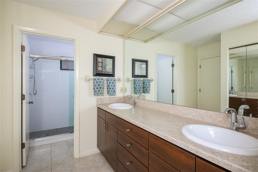 Master en suite bathroom with dual vanity, new fixtures, new step in shower with subway tile and penny tile shower floor. - Townhouse for sale at 5319 Huntingwood Ct #51, Sarasota, FL 34235 - MLS Number is A4460231