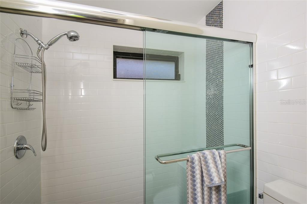 New walk in shower with stylish penny tile accent tile. - Townhouse for sale at 5319 Huntingwood Ct #51, Sarasota, FL 34235 - MLS Number is A4460231