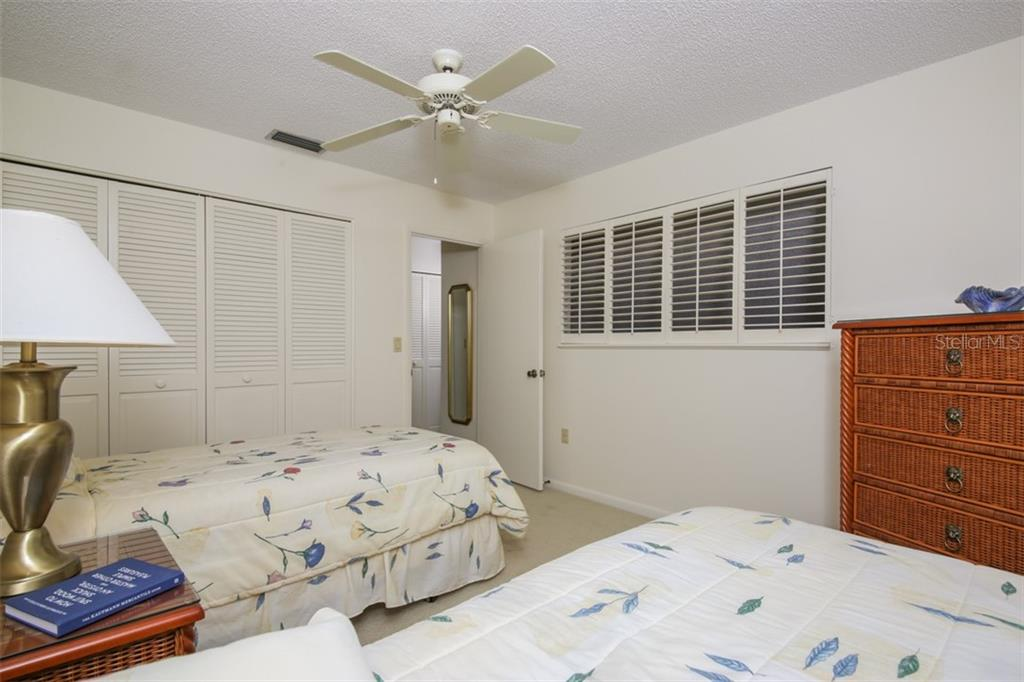 Third guest bedroom view to plantation shutters. - Townhouse for sale at 5319 Huntingwood Ct #51, Sarasota, FL 34235 - MLS Number is A4460231