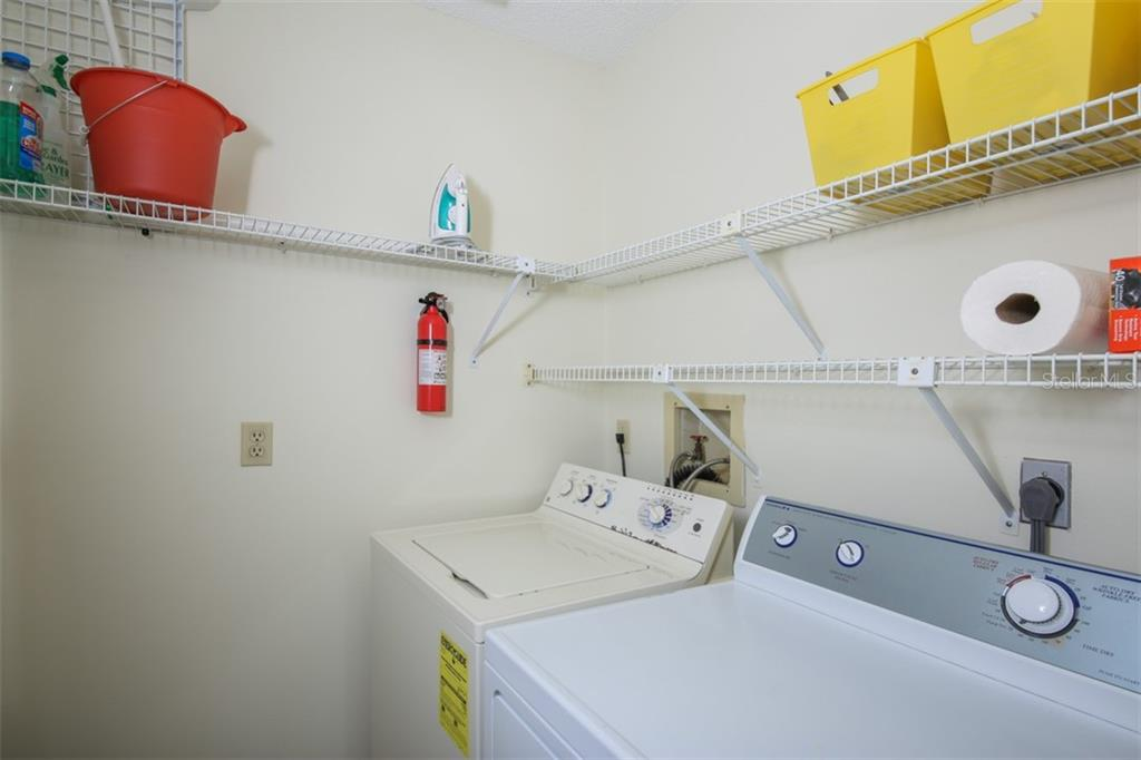 First floor laundry room with extra storage space ensures one floor living convenience and private space for guests upstairs. - Townhouse for sale at 5319 Huntingwood Ct #51, Sarasota, FL 34235 - MLS Number is A4460231