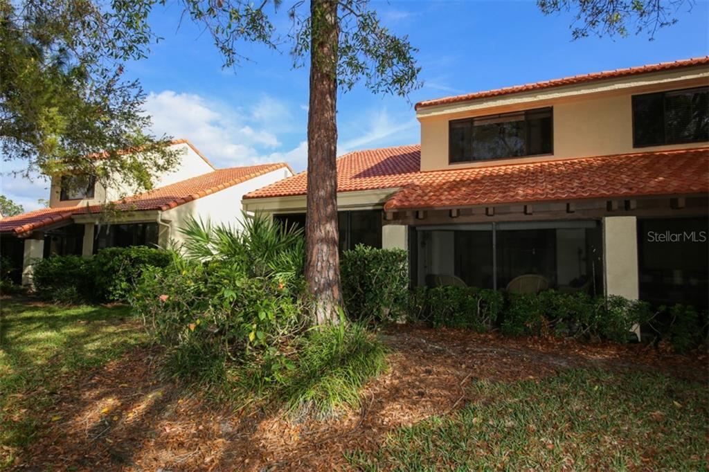 Rear view of townhome showing lanai. - Townhouse for sale at 5319 Huntingwood Ct #51, Sarasota, FL 34235 - MLS Number is A4460231