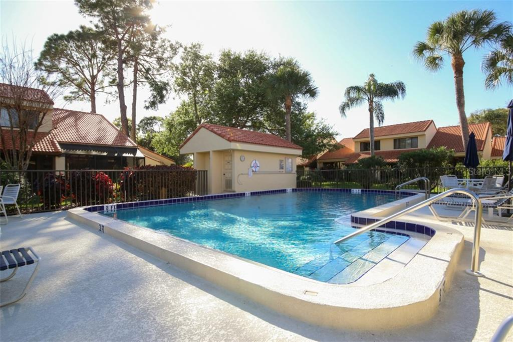 Huntingwood has two heated pools, a great place to meet friendly neighbors. - Townhouse for sale at 5319 Huntingwood Ct #51, Sarasota, FL 34235 - MLS Number is A4460231