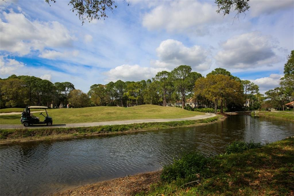 Watch the golfers approach your view over the green and enjoy an unending water view from your town home. - Townhouse for sale at 5319 Huntingwood Ct #51, Sarasota, FL 34235 - MLS Number is A4460231