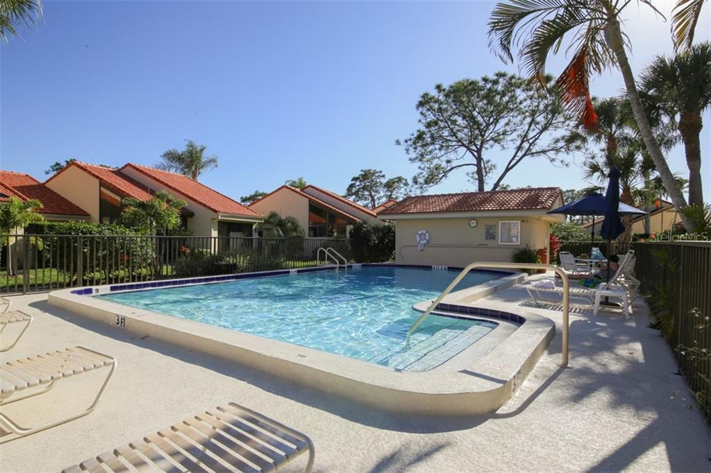 One of two sparkling heated community pools in Huntingwood. - Townhouse for sale at 5319 Huntingwood Ct #51, Sarasota, FL 34235 - MLS Number is A4460231
