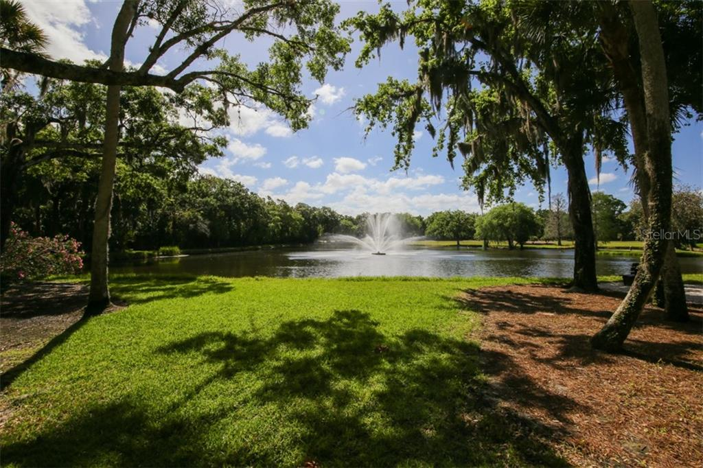 One of the beautiful lakes with fountains found in The Meadows. - Townhouse for sale at 5319 Huntingwood Ct #51, Sarasota, FL 34235 - MLS Number is A4460231