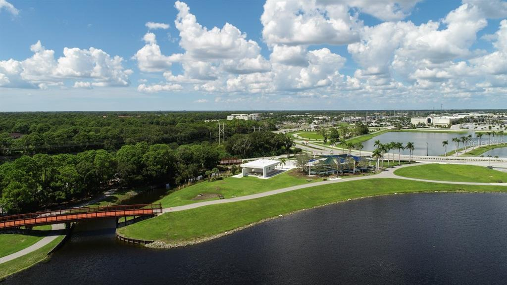 Bridges, walking and bike paths along the lake at neighboring park.  The Meadows is on the left with acres of mature trees. - Townhouse for sale at 5319 Huntingwood Ct #51, Sarasota, FL 34235 - MLS Number is A4460231