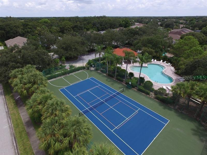 Aerial View of Palm Aire Country Club Tennis Courts and Pool - Single Family Home for sale at 5831 Fairwoods Cir, Sarasota, FL 34243 - MLS Number is A4460355