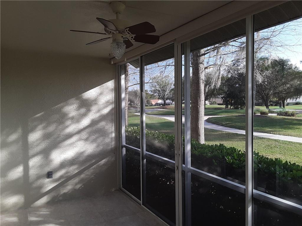 Enclosed Lanai with ceiling fan - Condo for sale at 6866 Fairview Ter #11, Bradenton, FL 34203 - MLS Number is A4460434