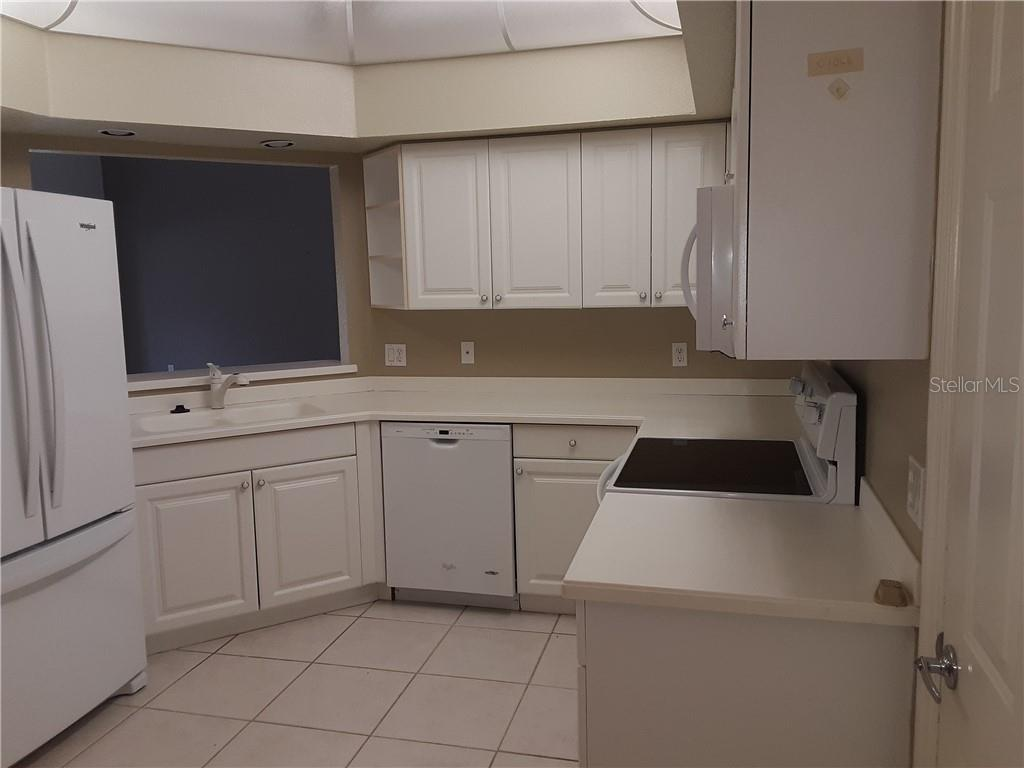 Kitchen-Microwave 2019 - Condo for sale at 6866 Fairview Ter #11, Bradenton, FL 34203 - MLS Number is A4460434