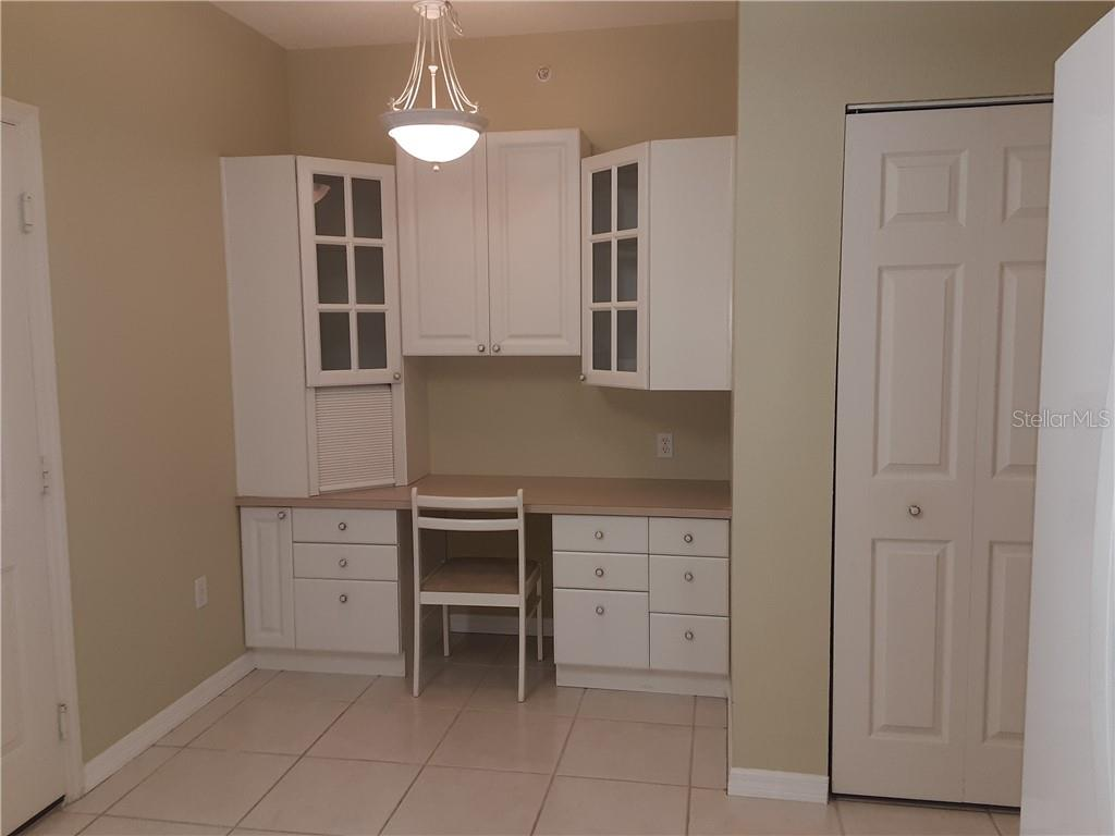 Built-in desk, pantry and additional cabinets in kitchen - Condo for sale at 6866 Fairview Ter #11, Bradenton, FL 34203 - MLS Number is A4460434