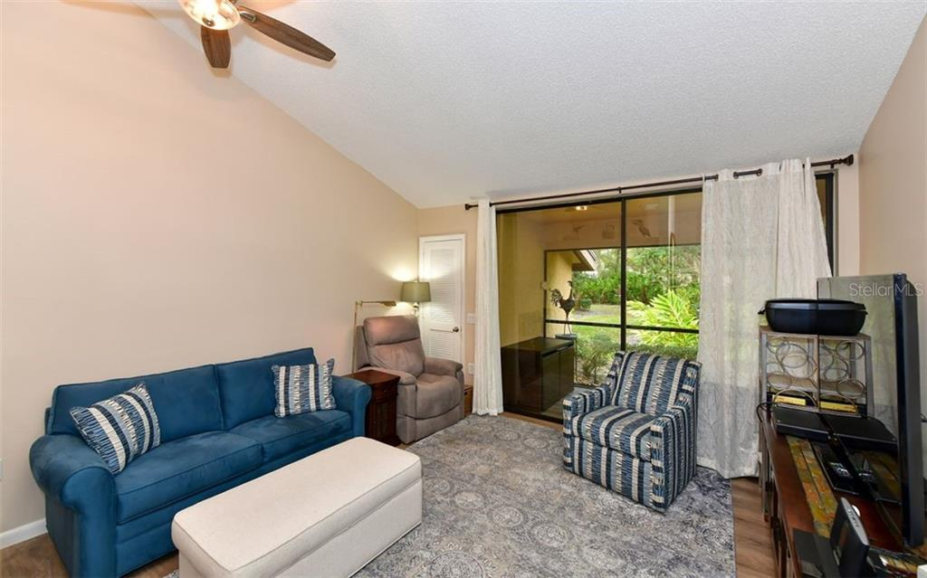 Family room with vaulted ceilings, large pantry closet to the left-great storage - Condo for sale at 4613 Morningside #30, Sarasota, FL 34235 - MLS Number is A4460777