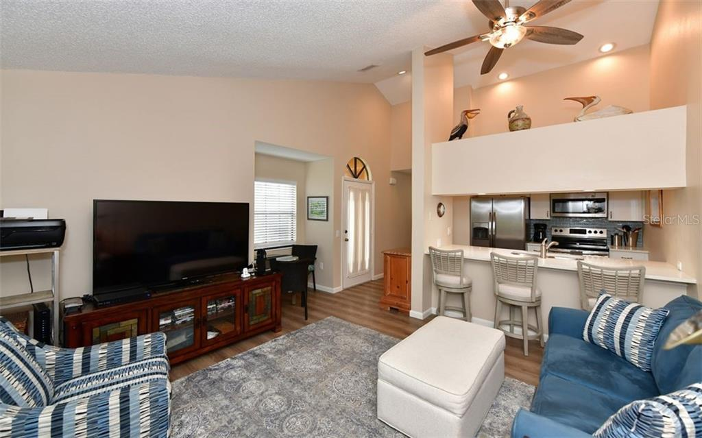 Family room with vaulted ceilings, open to the kitchen as well. - Condo for sale at 4613 Morningside #30, Sarasota, FL 34235 - MLS Number is A4460777